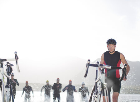 Triathletes emerging from water, - CAIF03861