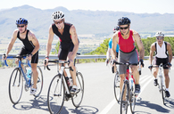 Cyclists in race on rural road - CAIF03864