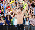 Fans cheering behind performer on stage at music festival - CAIF03885