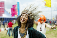 Women in costumes dancing at music festival - CAIF03900
