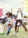 Enthusiastic friends dancing at music festival - CAIF03921