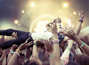 Performer crowd surfing at music festival - CAIF03954