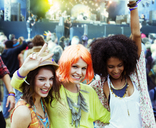 Portrait of cheering friends at music festival - CAIF03957