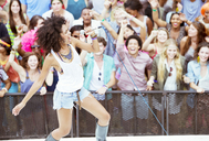 Fans cheering for performer singing on stage at music festival - CAIF03996
