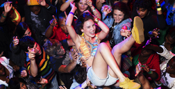 Enthusiastic woman crowd surfing at music festival - CAIF03999