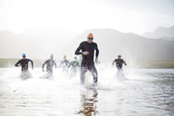 Triathletes emerging from water - CAIF04087