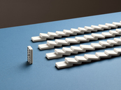 One standing domino and toppled dominoes in rows - CAIF04189