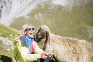 Hiker with sheep, selfie, laughing - CVF00245