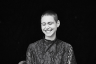 Portrait of happy short-haired young woman - FMKF04885