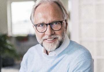 Portrait of smiling mature man with  grey hair and beard wearing glasses - UUF12947