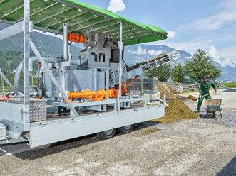 Farmer working with fertilizer on a farm - CVF00260