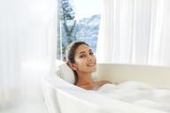 Portrait smiling woman relaxing enjoying bubble bath - HOXF00113