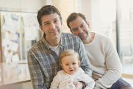 Portrait smiling male gay parents with baby son - CAIF04295
