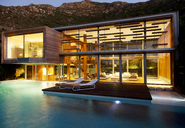 Swimming pool and modern house at night - CAIF04415