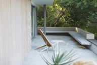 Chair and table on modern patio - CAIF04517