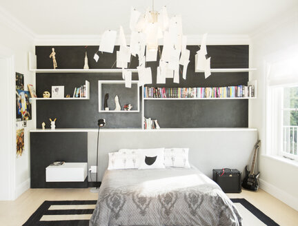 Modern paper chandelier hanging over bed in bedroom - HOXF00191