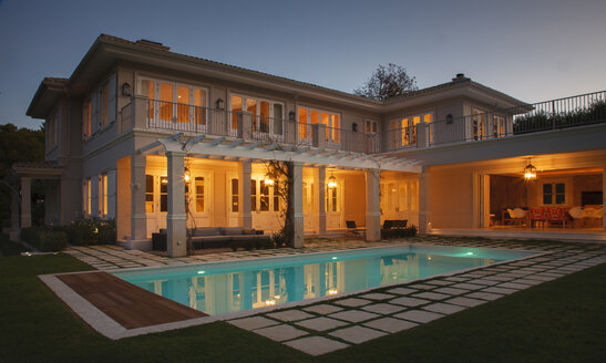Illuminated luxury house with swimming pool at night - HOXF00206