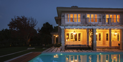 Illuminated luxury house with swimming pool at night - HOXF00209