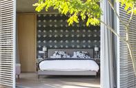 Patio shutters open to luxury bedroom - HOXF00248