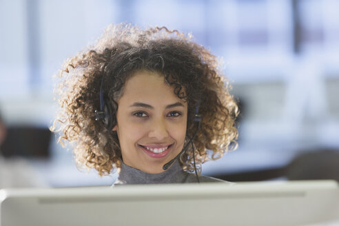 Portrait confident businesswoman with headset in office - HOXF00425