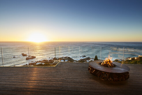 Fire pit on luxury patio with sunset ocean view - HOXF00461