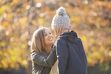 Affectionate mother touching son's face outdoors - HOXF00623