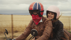 Young couple riding motorcycle in rural countryside - HOXF00782