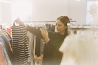 Fashion buyer photographing striped shirt - HOXF00908