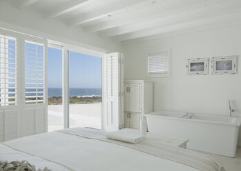 White hotel room with en suite soaking tub and ocean view - HOXF00971