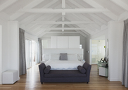 White vaulted wood beam ceiling over bed in home showcase interior - HOXF00986