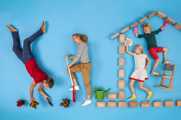 Children are cleaning the house, while parents are working in the garden - BAEF01599