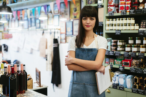 Portrait of smiling woman in a store - EBSF02198