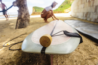 Indonesia, Lombok, surf board and suncream - KNTF01045