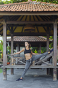 Indonesia, Bali, woman stretching - KNTF01073