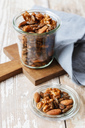 Homemade roasted flavored nuts, almonds, walnuts and pumpkin seeds in glass - EVGF03301