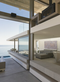 Modern, luxury home showcase interior living room with ocean view - HOXF01045
