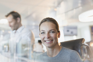 Portrait smiling businesswoman in office - HOXF01162