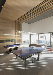 Pool table and ping pong table in modern, luxury home showcase interior game room - HOXF01300