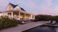 White home showcase exterior beach house at dusk - HOXF01357