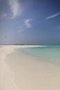 Tranquil tropical ocean beach under sunny blue sky - HOXF01441