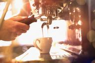 Close up barista using espresso machine - HOXF01459