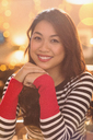 Portrait smiling Chinese woman wearing striped sweater - HOXF01486