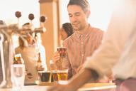 Man sampling beer at microbrewery bar - HOXF01501