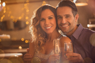 Portrait smiling couple drinking champagne - HOXF01540