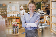 Portrait smiling female business owner working in shop - HOXF01804