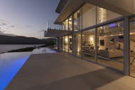 Tranquil modern luxury home showcase exterior with lap pool and dusk ocean view - HOXF02101