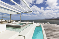 Sunny, tranquil modern luxury patio with swimming pool and footbridge with ocean view - HOXF02134
