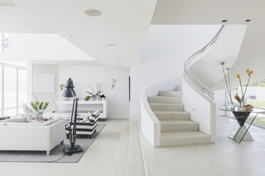 White modern luxury home showcase spiral staircase and living room - HOXF02140