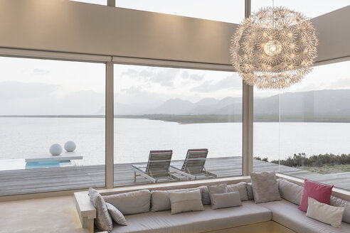 Modern luxury home showcase interior living room with chandelier and ocean view - HOXF02155