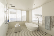 Minimalist, modern luxury home showcase bathroom with soaking tub and shower - HOXF02158